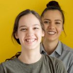portrait of two girls smiling for article on the transformation principle, a new book by joe bailey about the three principles of mind, thought, and consciousness